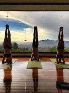 3 handstands in HIIT yoga session