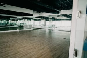 View of the empty YogaSol Heated Studio with mirrors on all walls