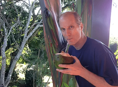 Dan Markowitz sipping from coconut