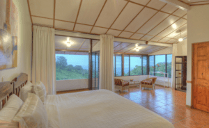 Pura Vida Spa Upper Kiva View of Room with Bed & Sitting Area over looking the Costa Rica Valley at Yoga Retreat